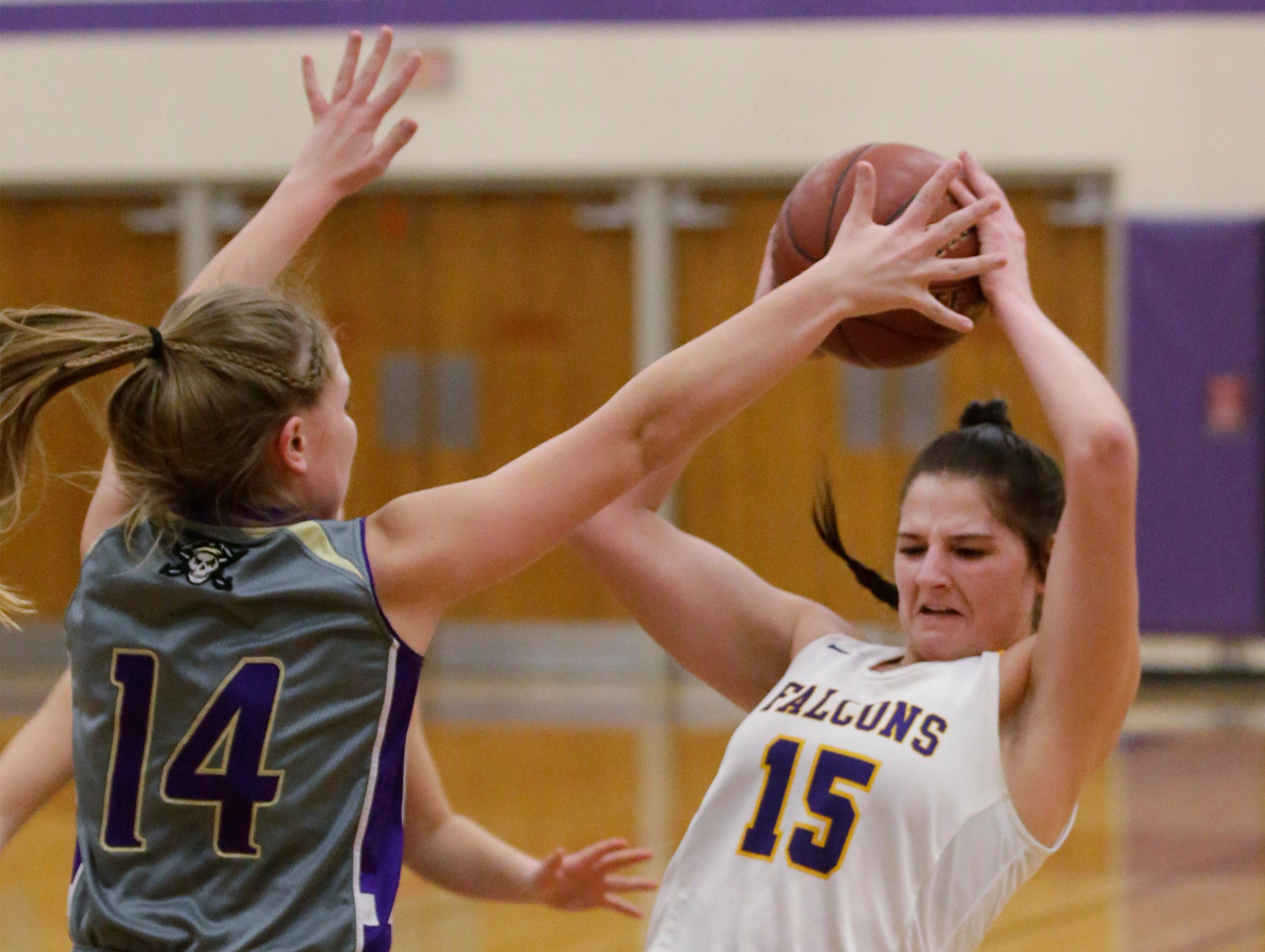 Sheboygan Falls' Myja Durn (15) keeps the ball away from Two Rivers' Andrea Hendrickson (14), Thursday, February 14, 2019, in Sheboygan Falls, Wis.