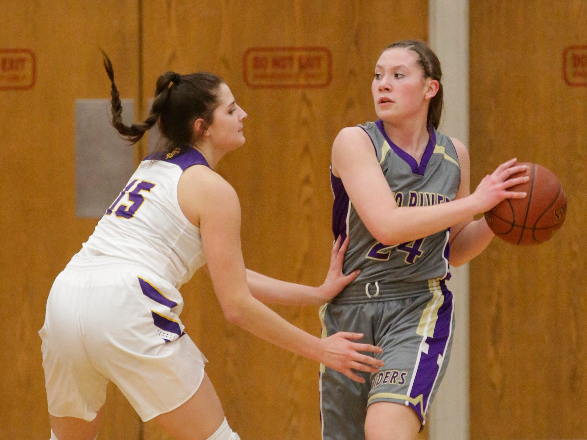 Sheboygan Falls' Myja Durn (15) guards Two Rivers' Kiley Graff (24), Thursday, February 14, 2019, in Sheboygan Falls, Wis.