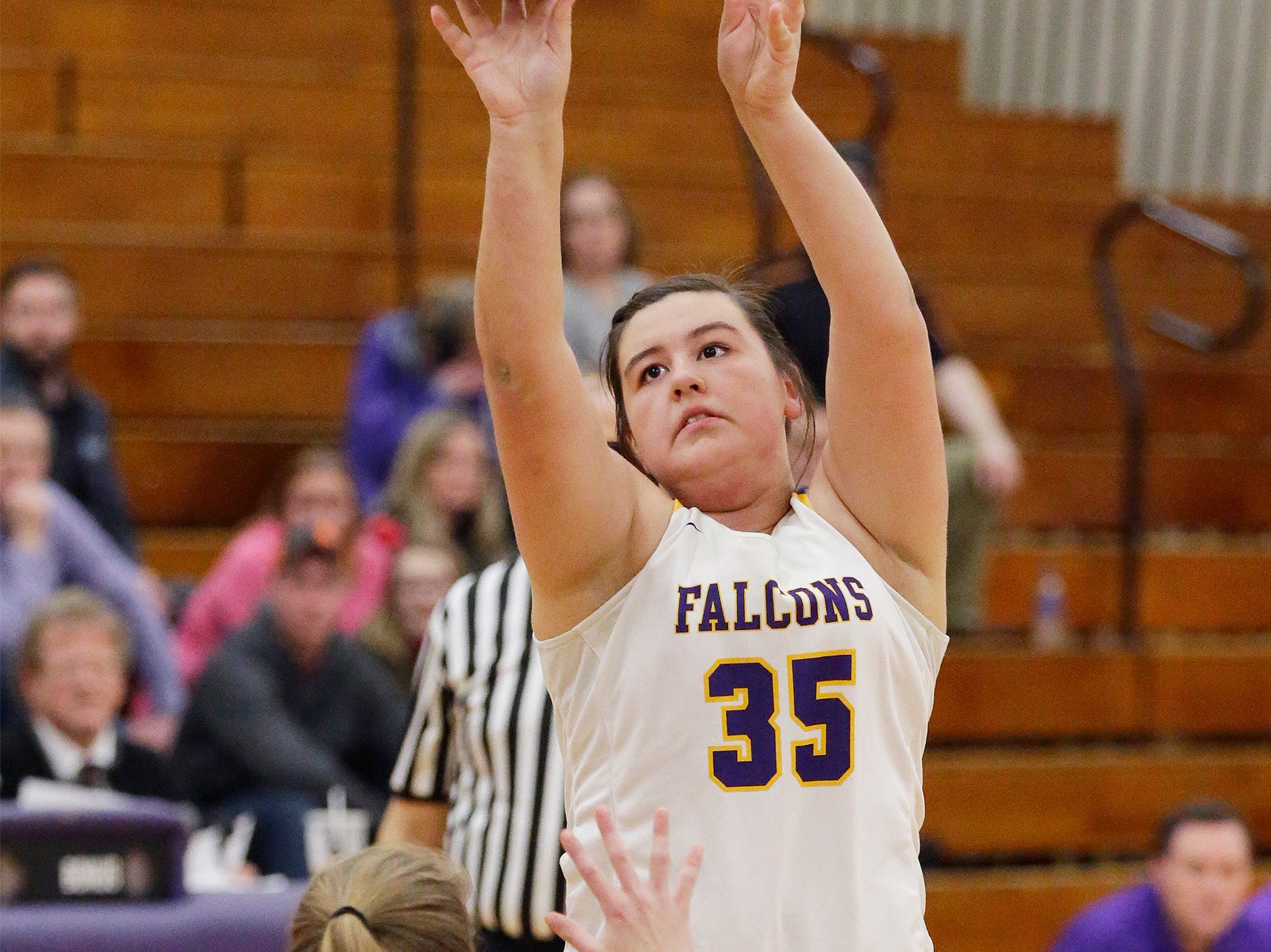 Sheboygan Falls'  Jordyn Girdaukas (35) launches a shot by Two Rivers' Emma Cooley (13), Thursday, February 14, 2019, in Sheboygan Falls, Wis.