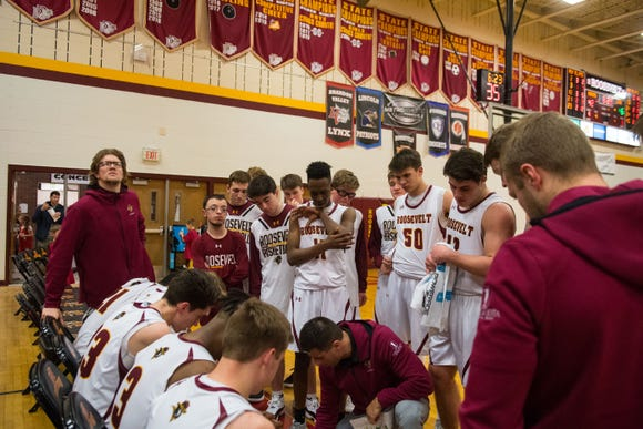 Roosevelt team huddles during a game against Brandon Valley in Sioux Falls, S.D., Thursday, Feb. 14, 2019.