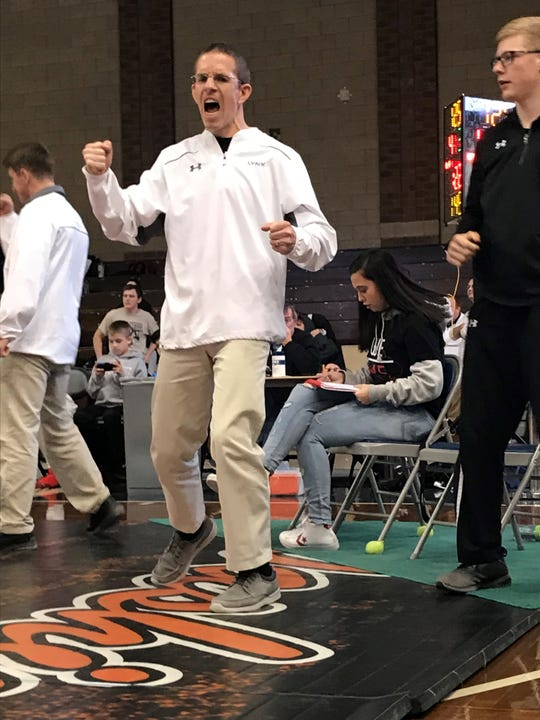 Brandon Valley coach Derek Outland reacts after a victory at the Region 2A wrestling tournament at the Sioux Falls Pentagon on Friday, Feb. 15, 2019.