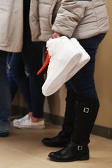 Susie Stonehouse brought her son Riley Stonehouse's shoes to the Lincoln County Courthouse Friday, Feb. 15, in Canton. Stonehouse used the pair of shoes to demonstrate lost opportunities. Riley had ordered a pair of size 16 shoes a few days before he was murdered. The shoes came in the day after he was killed.