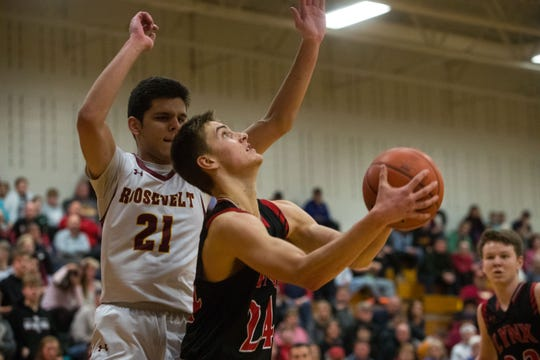Roosevelt's Aidan Evans (21) attempts to block Brandon Valley's Evan Talcott (24) from making a shot during a game in Sioux Falls, S.D., Thursday, Feb. 14, 2019.
