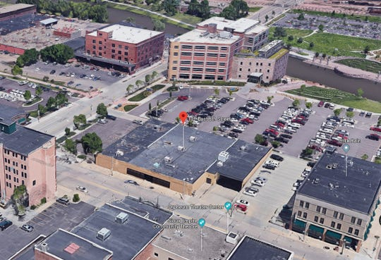 A view of the David A. Christiansen building – also called the DAC building – at 101 E. Sixth St. in downtown Sioux Falls, in the center of the photo, looking northeast. Phillips Avenue is in the foreground and the Raven Industries HQ is top-center along Sixth Street.