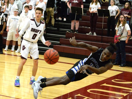 Lee High's Kaleb Hall tries to save the ball from going out of bounds Thursday during the Shenandoah District Tournament championship game.