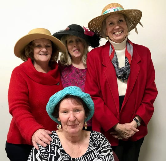 Kay McDonagh, Donna Berdeaux and Jo Anne Sabas stand behind Laura Hiatt to pose for a group photo at Augusta Health's Stronger Together breast cancer support group on Thursday, February 14, 2019 in Fishersville. They all decided to wear hats for a special Valentine's Day afternoon tea together.