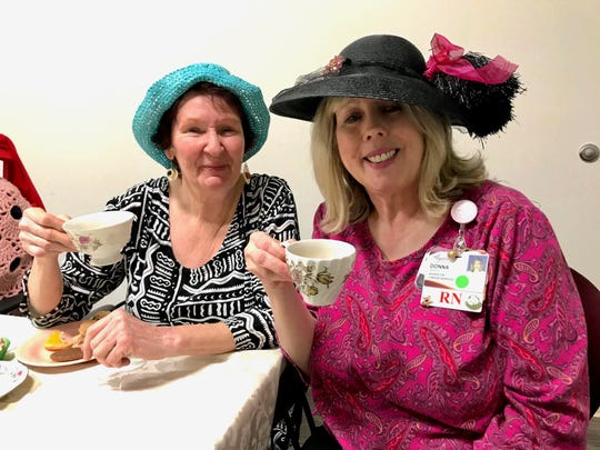Laura Hiatt sits beside Donna Berdeaux, breast navigator at Augusta Health in Fishersville on Thursday, February 14, 2019. Hiatt was diagnosed with breast cancer three years ago during a routine mammogram. On the day she found out, she said she was in shock and Berdeaux was sitting beside her then to help her. Every Thursday she and a group of women get together at Augusta Health's Stronger Together breast cancer support group. Originally from England, Hiatt planned an afternoon tea  for the group on Valentine's Day.