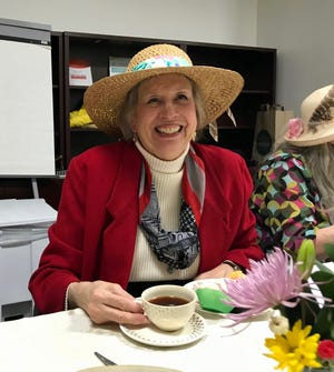 Jo Anne Sabas, of Swoope, enjoys a cup of tea at Augusta Health's Stronger Together breast cancer support group  in Fishersville on Thursday, February 14, 2019 for Valentine's Day. Five years ago, Sabas missed a routine mammogram and when she got one the following year, she found out she had stage four metastatic breast cancer.