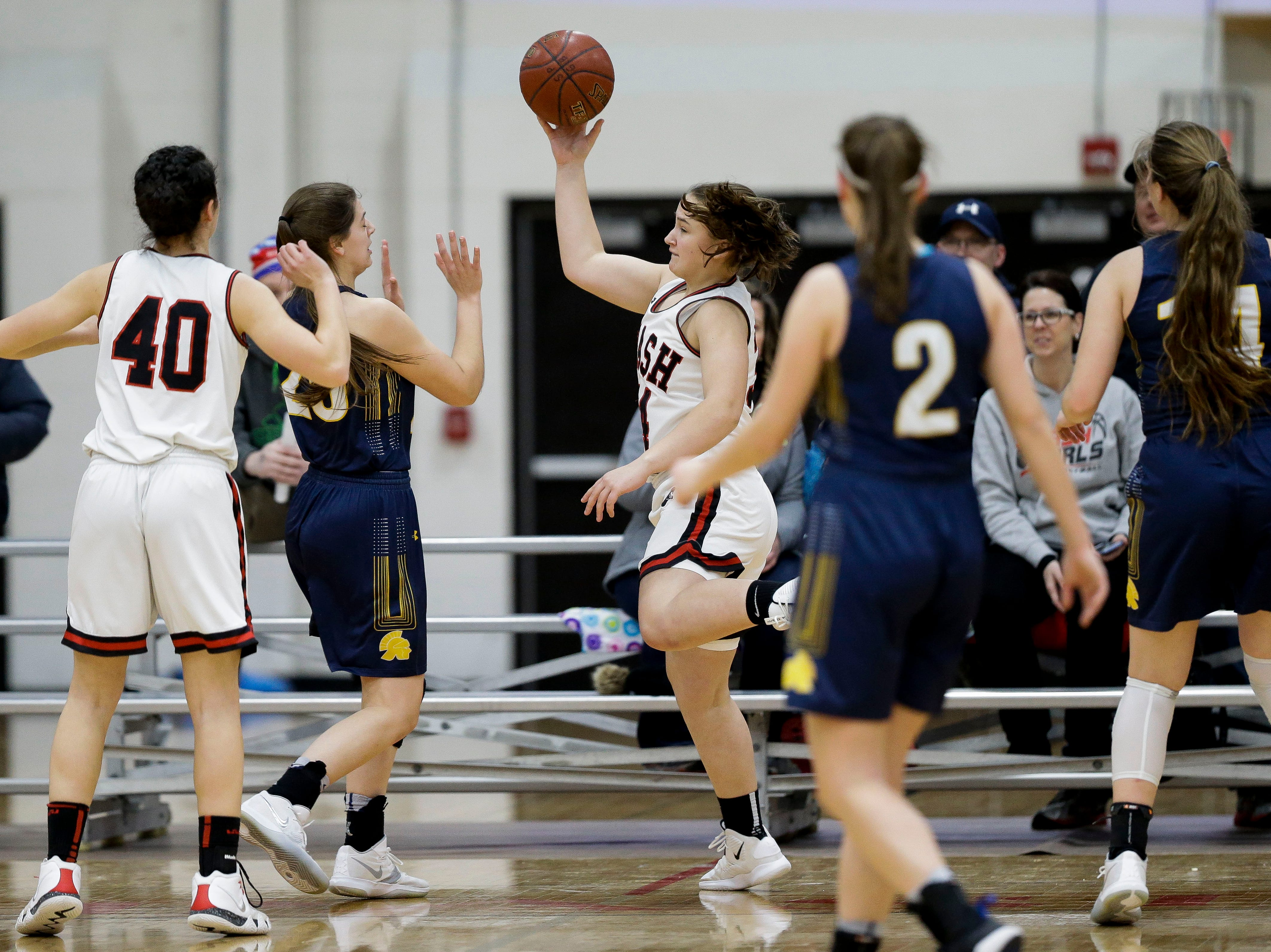 SPASH's Zoe Fink (34) saves a loose ball along the baseline against Wausau West on Thursday, February 14, 2019, at SPASH in Stevens Point, Wis.Tork Mason/USA TODAY NETWORK-Wisconsin