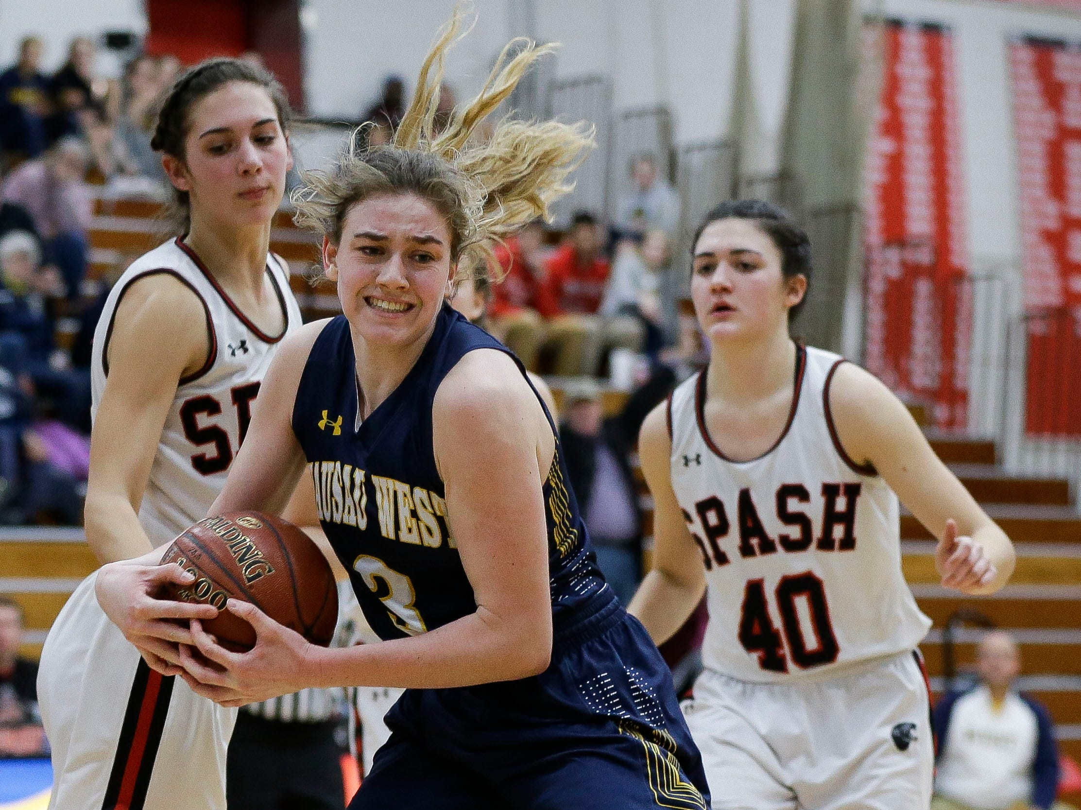 Wausau West's Kadie Deaton (3) grabs a rebound against SPASH on Thursday, February 14, 2019, at SPASH in Stevens Point, Wis.Tork Mason/USA TODAY NETWORK-Wisconsin