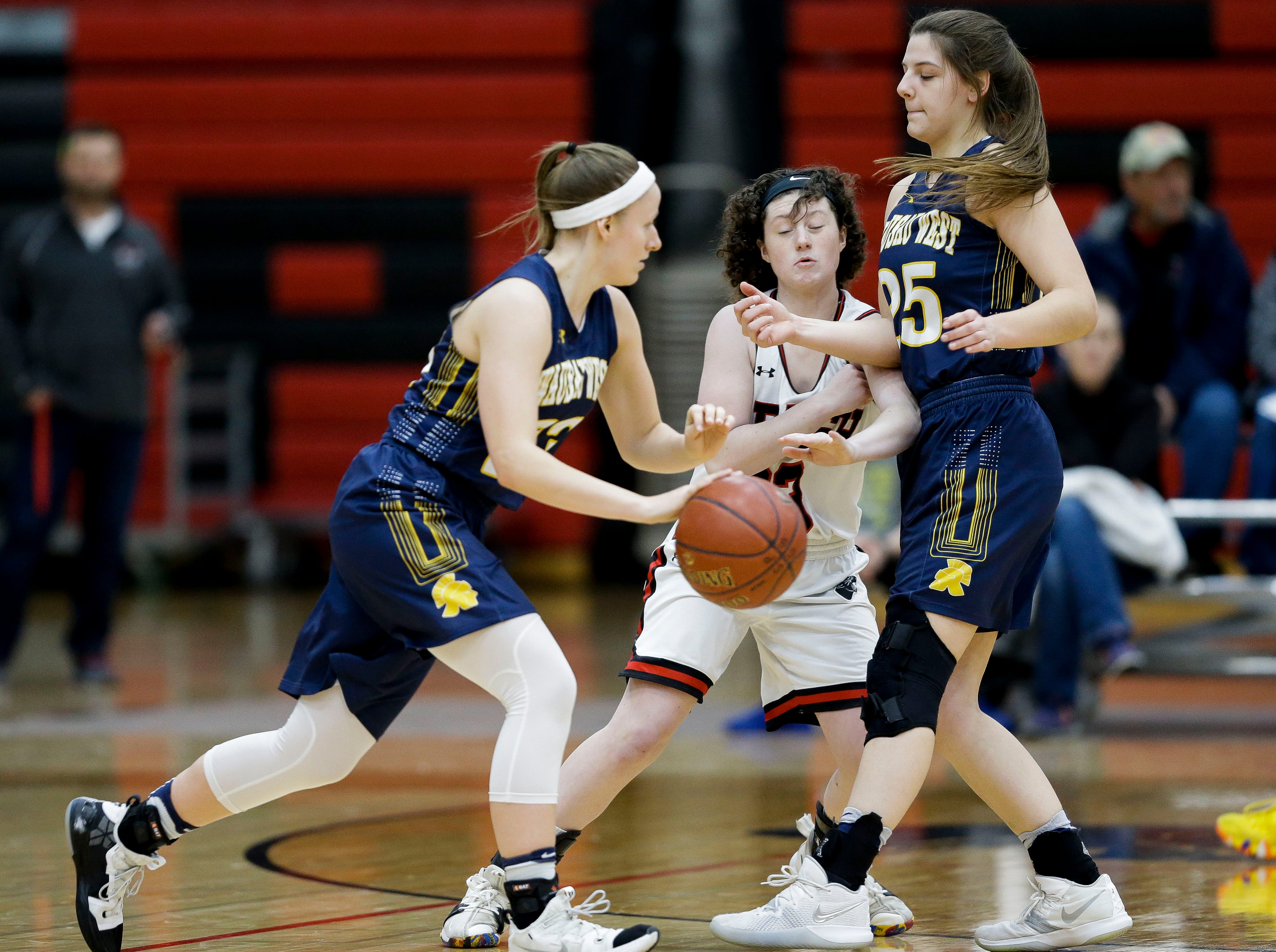 SPASH's Madisyn Rogan (center) fights through a screen against Wausau West on Thursday, February 14, 2019, at SPASH in Stevens Point, Wis.Tork Mason/USA TODAY NETWORK-Wisconsin