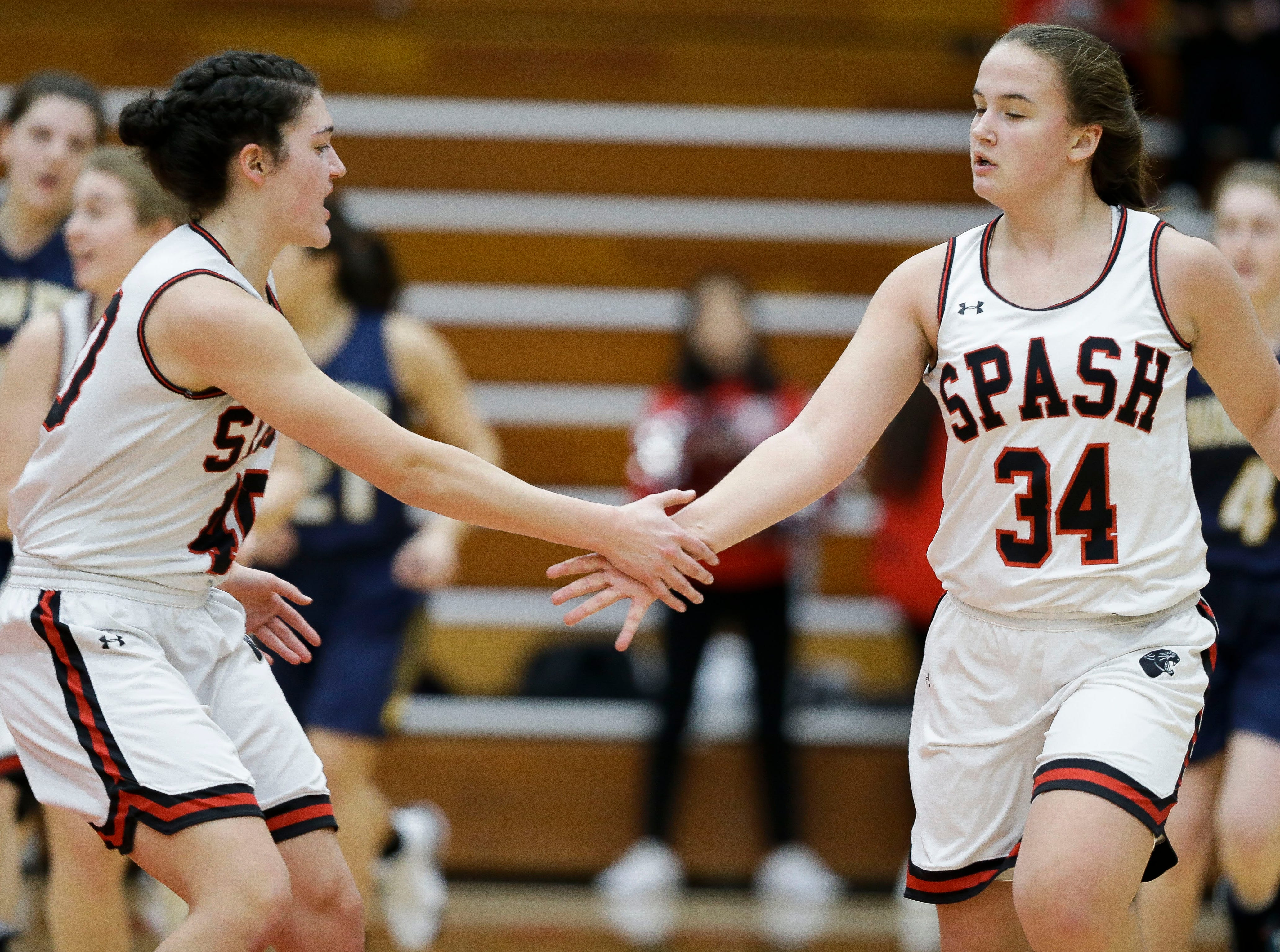 SPASH's Leah Earnest (40) congratulates SPASH's Zoe Fink (34) after a made 3-pointer against Wausau West on Thursday, February 14, 2019, at SPASH in Stevens Point, Wis.Tork Mason/USA TODAY NETWORK-Wisconsin