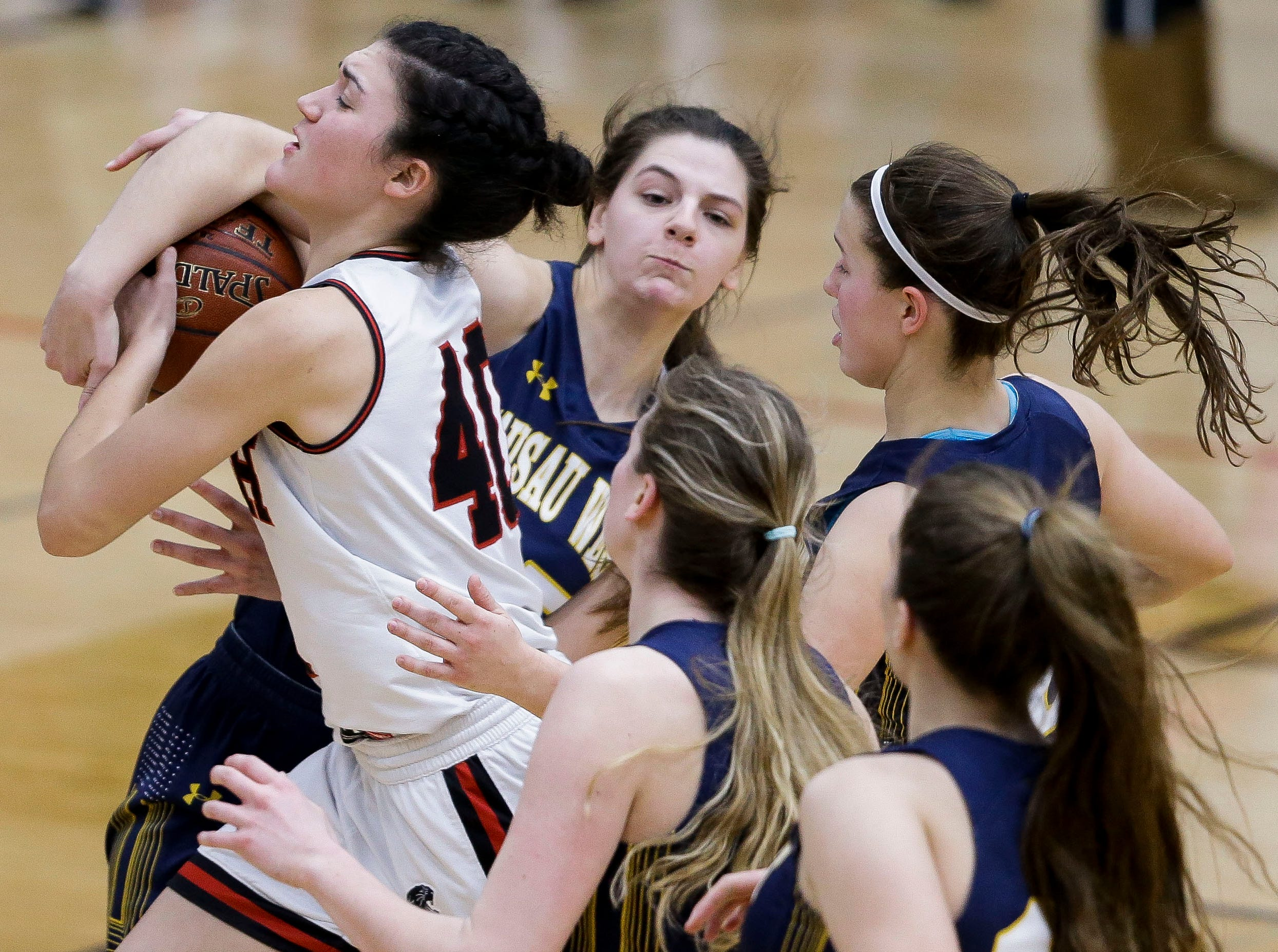 SPASH's Leah Earnest (40) is fouled by Wausau West's Tess Hauer (25) on her way to the basket on Thursday, February 14, 2019, at SPASH in Stevens Point, Wis.Tork Mason/USA TODAY NETWORK-Wisconsin