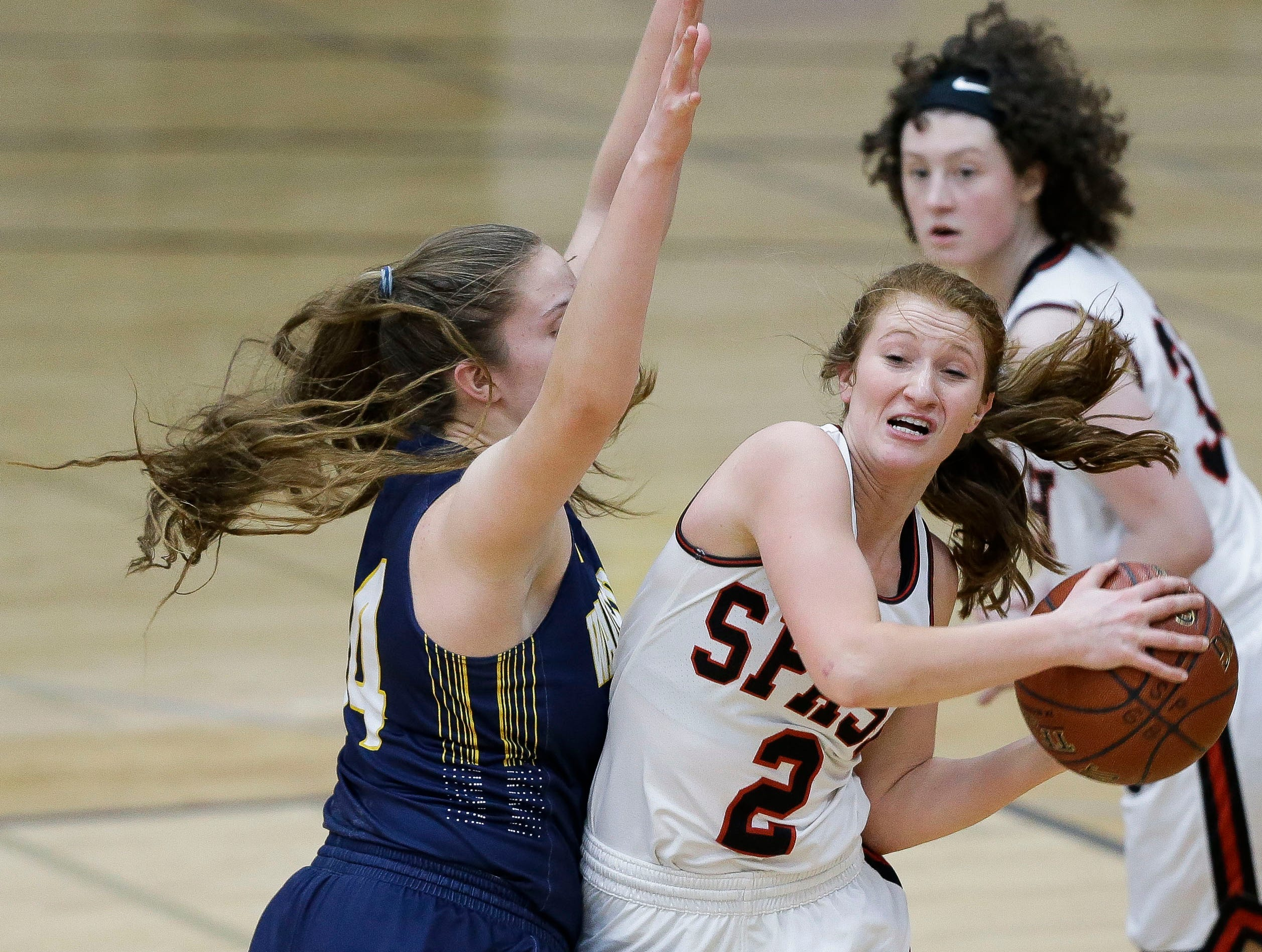 SPASH's Rachel Lummis (2) looks to pass after grabbing a rebound against Wausau West on Thursday, February 14, 2019, at SPASH in Stevens Point, Wis.Tork Mason/USA TODAY NETWORK-Wisconsin