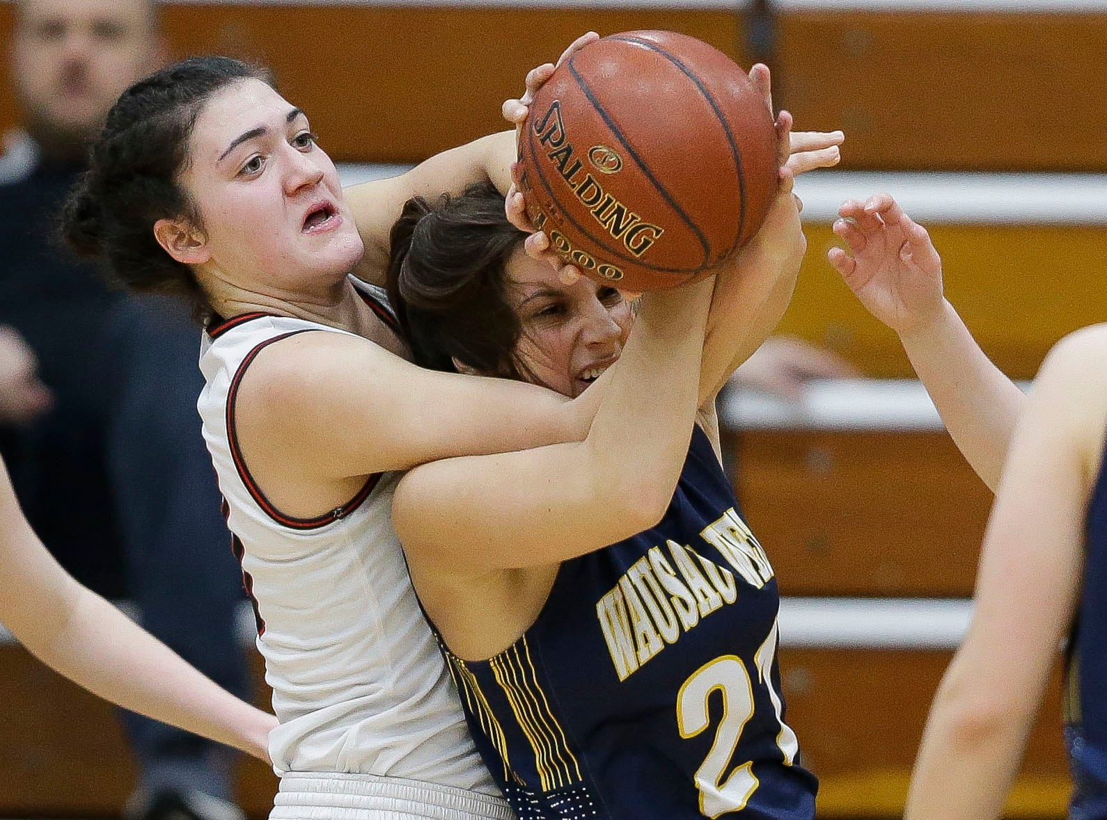 SPASH's Leah Earnest (left) fights for a rebound with Wausau West's Shpresa Shabani (21) on Thursday, February 14, 2019, at SPASH in Stevens Point, Wis.Tork Mason/USA TODAY NETWORK-Wisconsin