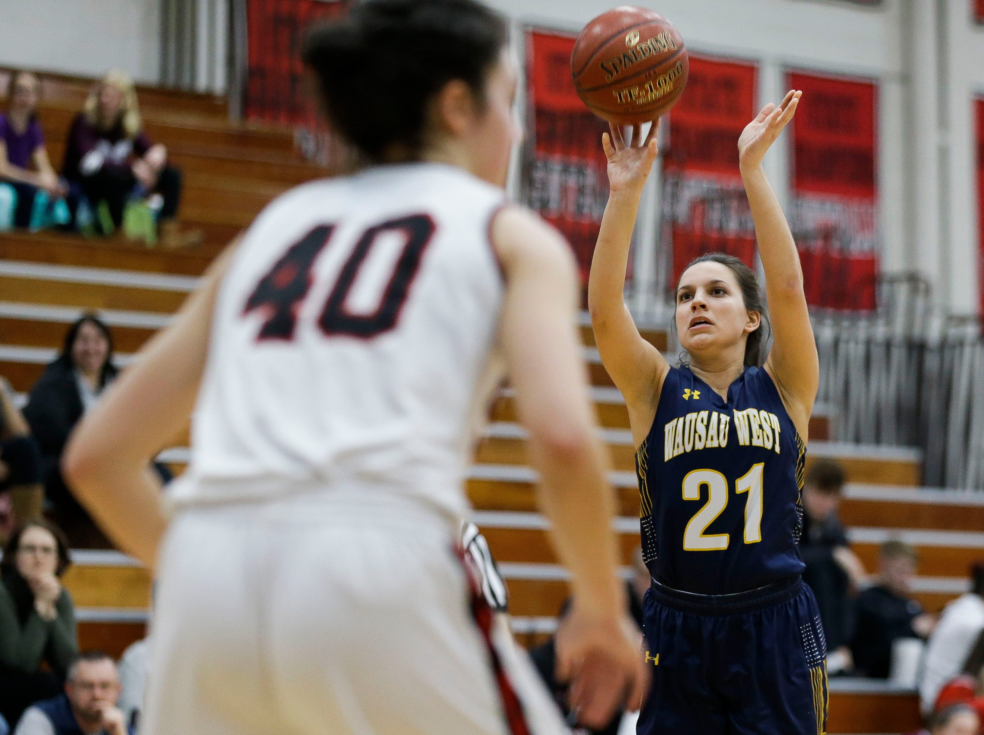 Wausau West's Shpresa Shabani (21) shoots a 3-pointer against SPASH on Thursday, February 14, 2019, at SPASH in Stevens Point, Wis.Tork Mason/USA TODAY NETWORK-Wisconsin