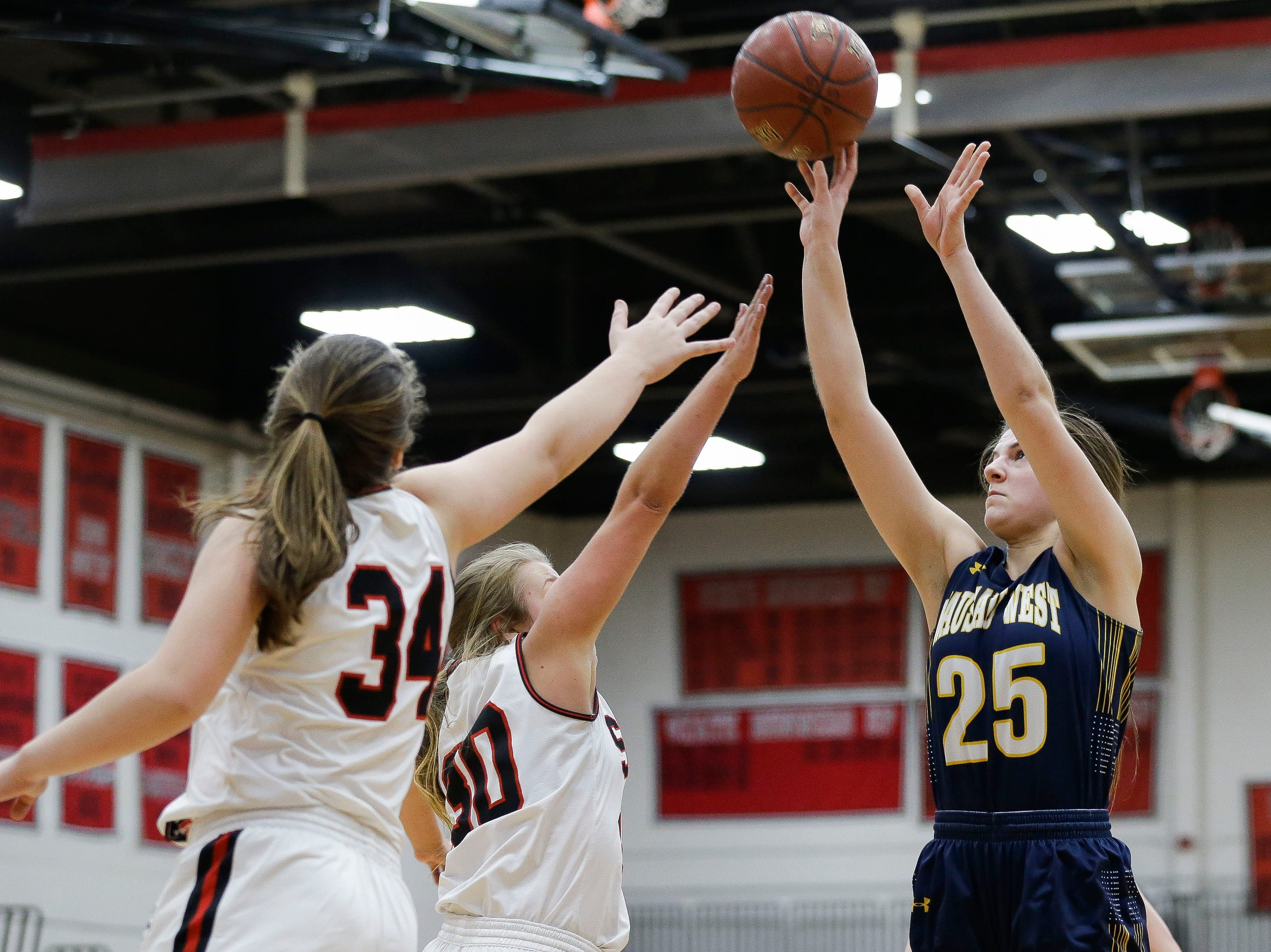 Wausau West's Tess Hauer (25) puts up a shot against SPASH on Thursday, February 14, 2019, at SPASH in Stevens Point, Wis.Tork Mason/USA TODAY NETWORK-Wisconsin