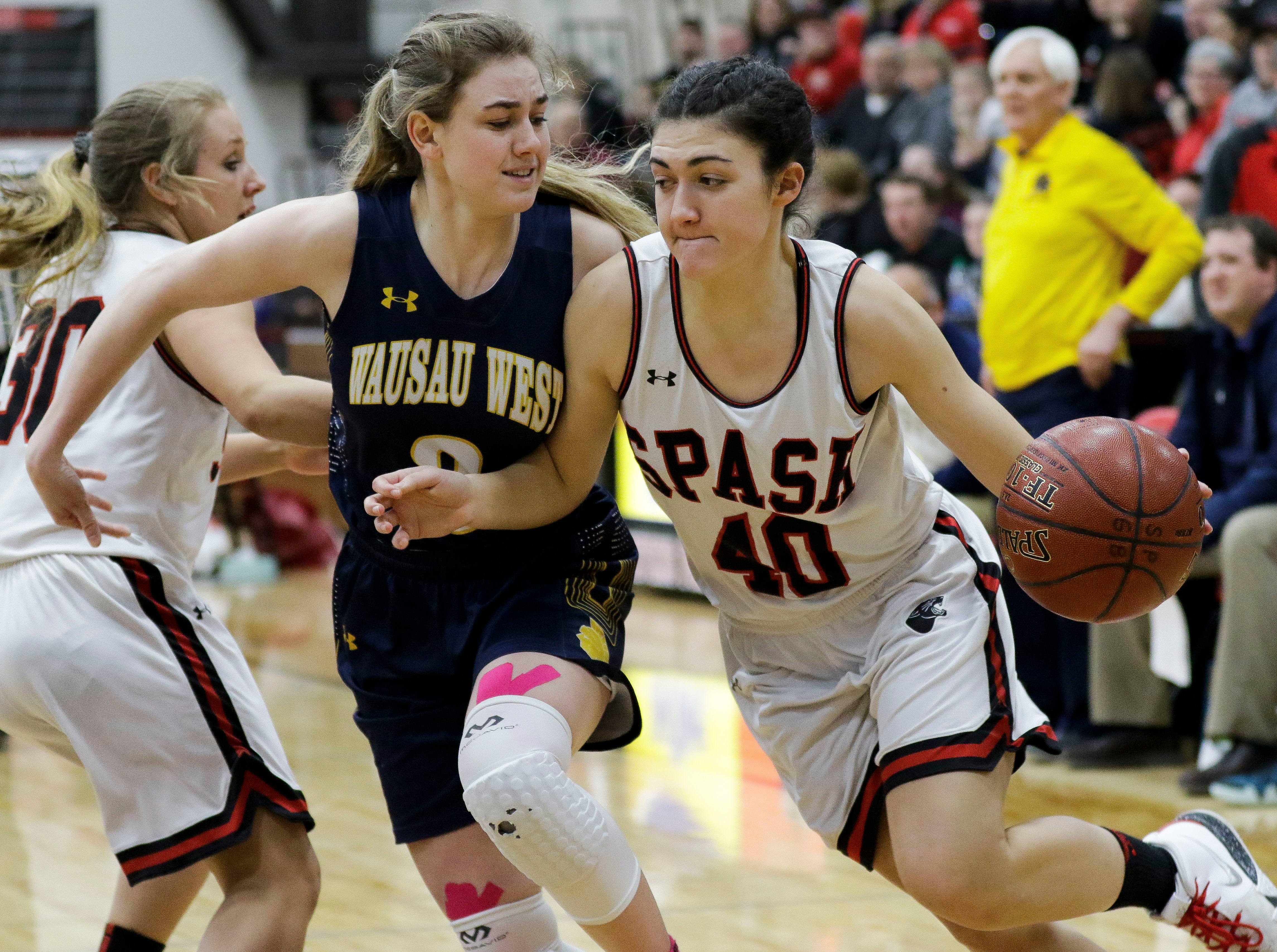 SPASH's Leah Earnest (40) drives the baseline against Wausau West's Kadie Deaton (3) on Thursday, February 14, 2019, at SPASH in Stevens Point, Wis.Tork Mason/USA TODAY NETWORK-Wisconsin