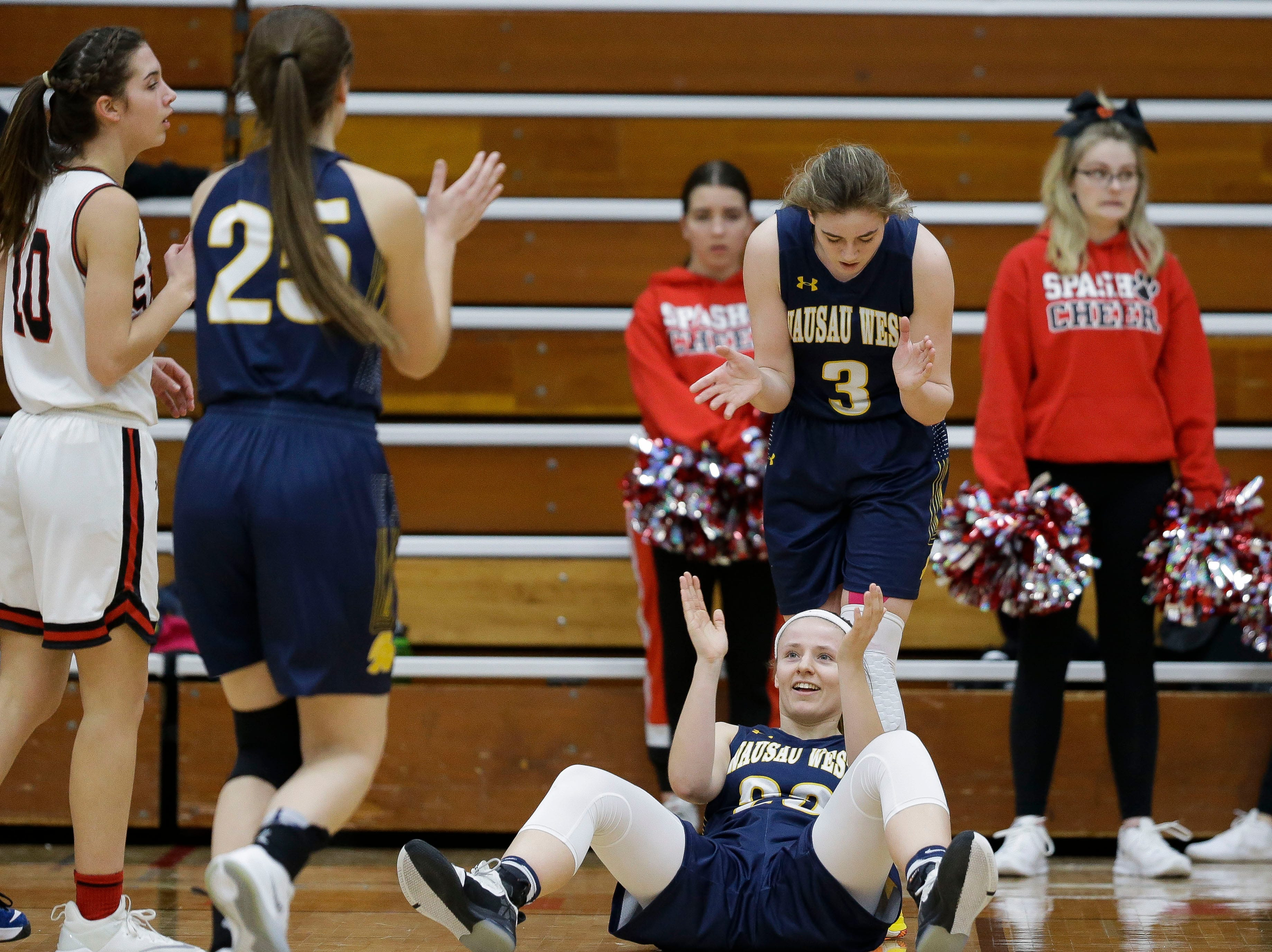 Wausau West's Maddie Schires (23) and Wausau West's Kadie Deaton (3) react after an apparent offensive foul against SPASH on Thursday, February 14, 2019, at SPASH in Stevens Point, Wis. The call was eventually overturned and Schires was called for a foul on the play.Tork Mason/USA TODAY NETWORK-Wisconsin