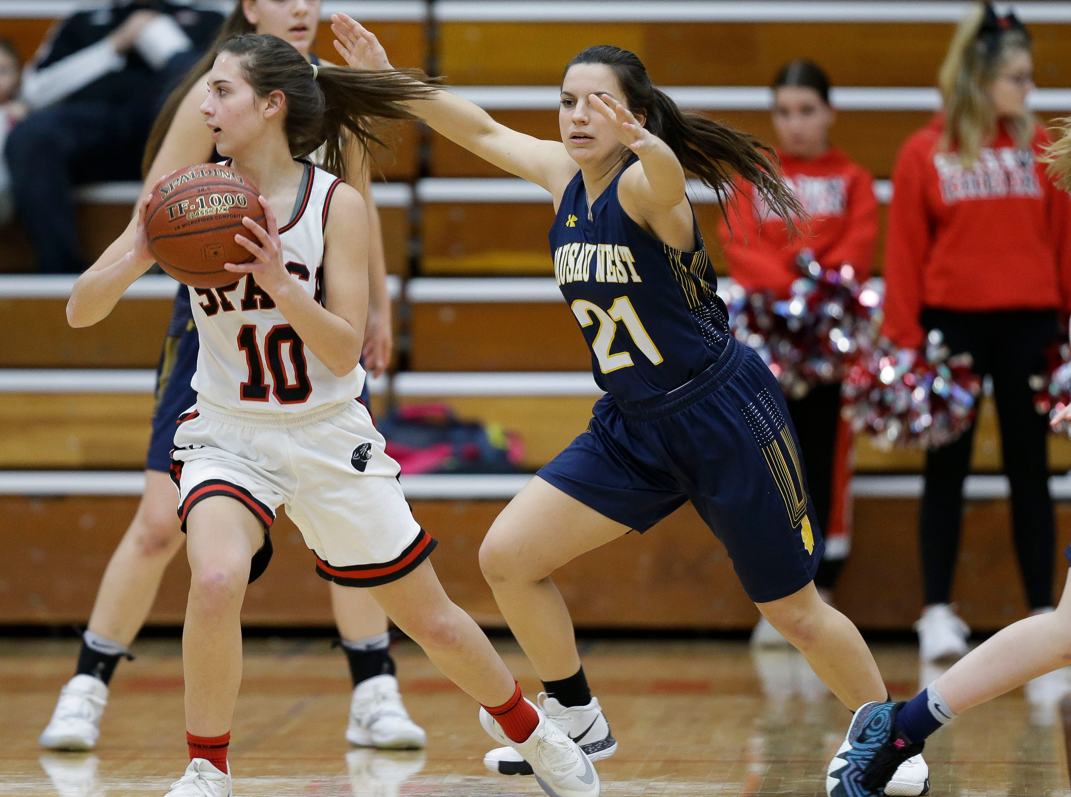 Wausau West's Shpresa Shabani (21) defends as SPASH's Alyssa Standifer (10) looks to pass on Thursday, February 14, 2019, at SPASH in Stevens Point, Wis.Tork Mason/USA TODAY NETWORK-Wisconsin