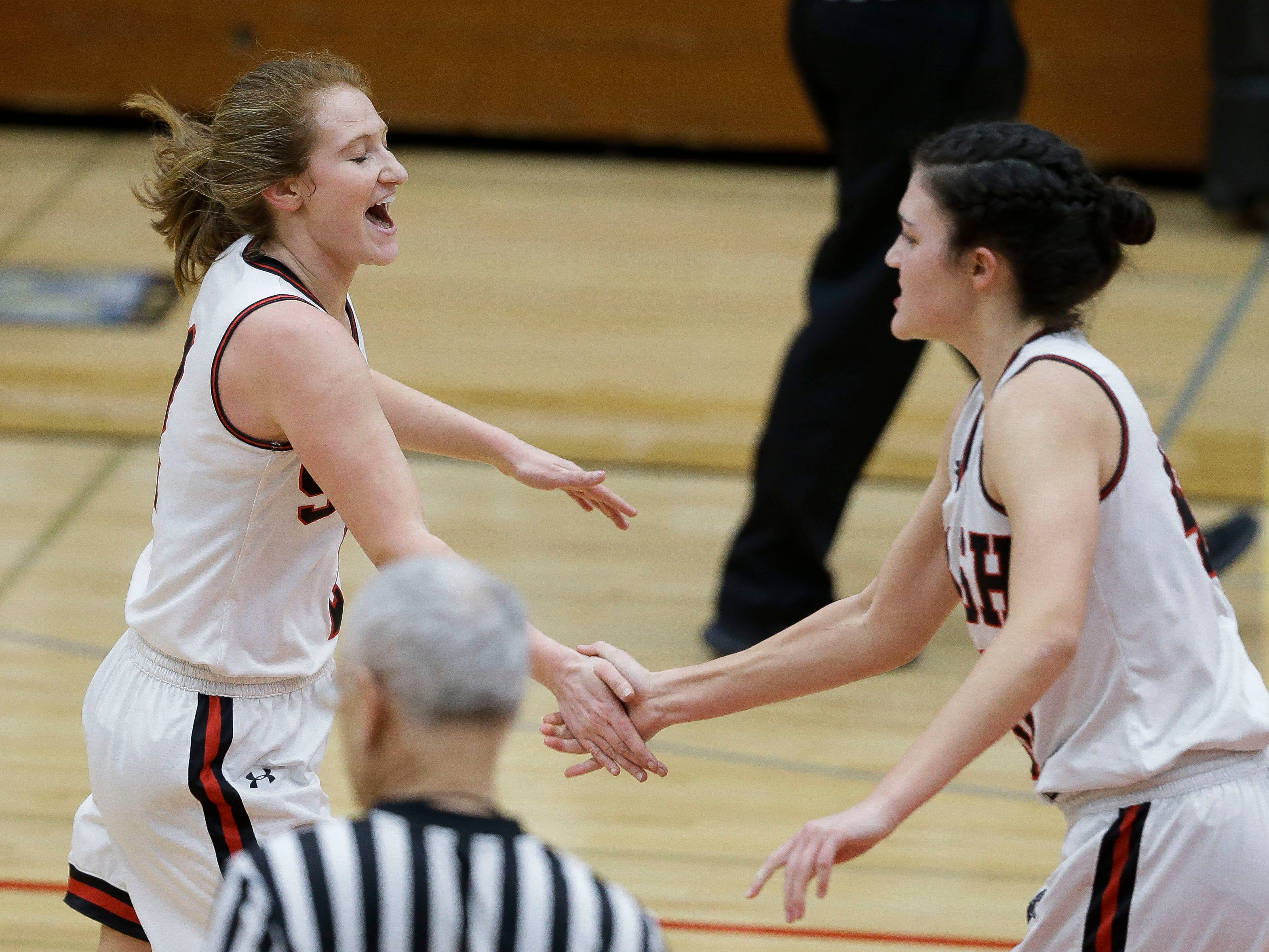 SPASH's Rachel Lummis (2) congratulates SPASH's Leah Earnest (40) after a made 3-pointer against Wausau West on Thursday, February 14, 2019, at SPASH in Stevens Point, Wis.Tork Mason/USA TODAY NETWORK-Wisconsin
