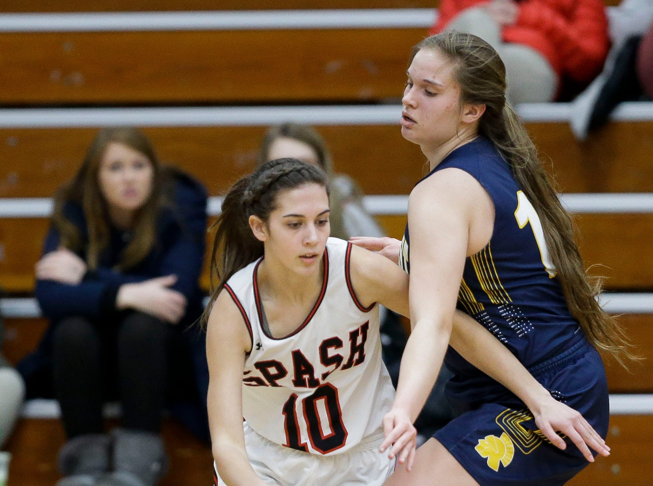 SPASH's Alyssa Standifer (10) is fouled by Wausau West's Anna Cunningham (14) on Thursday, February 14, 2019, at SPASH in Stevens Point, Wis.Tork Mason/USA TODAY NETWORK-Wisconsin