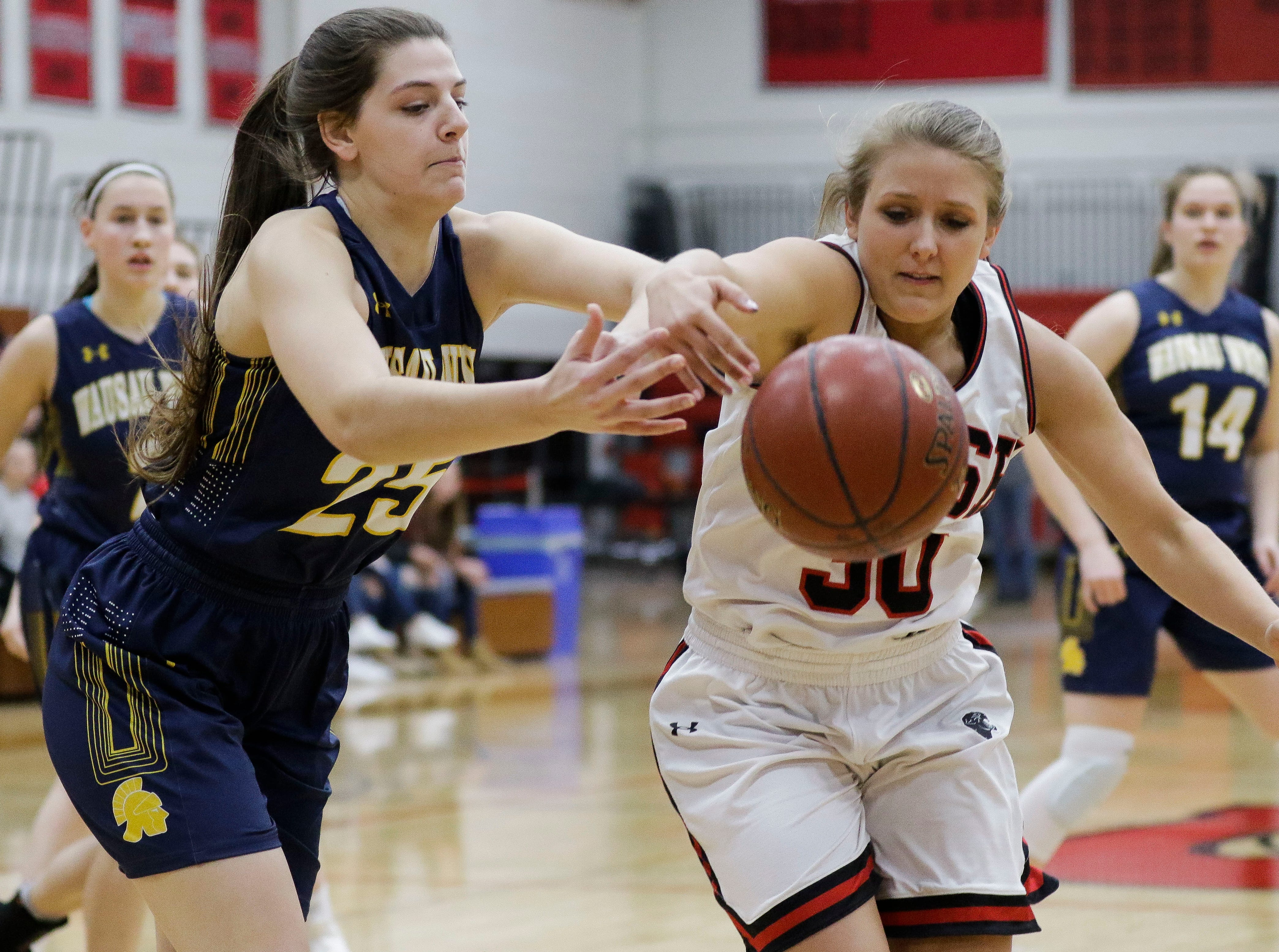 Wausau West's Tess Hauer (25) and SPASH's Kaylee Hintz (30) chase down a loose ball on Thursday, February 14, 2019, at SPASH in Stevens Point, Wis.Tork Mason/USA TODAY NETWORK-Wisconsin