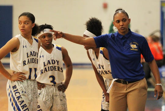 Rickards girls basketball coach Chariya Davis discusses strategy with her team as the Raiders beat Mosley 61-27 in a Region 1-6A quarterfinal on Feb. 14, 2019.