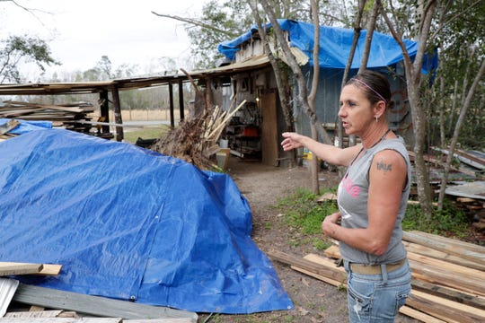 Shary Forte points a tree uprooted by Hurricane Michael behind her home in Bristol, Fla., Friday Feb. 15, 2019. Hurricane Michael hit the panhandle in Oct. 2018.