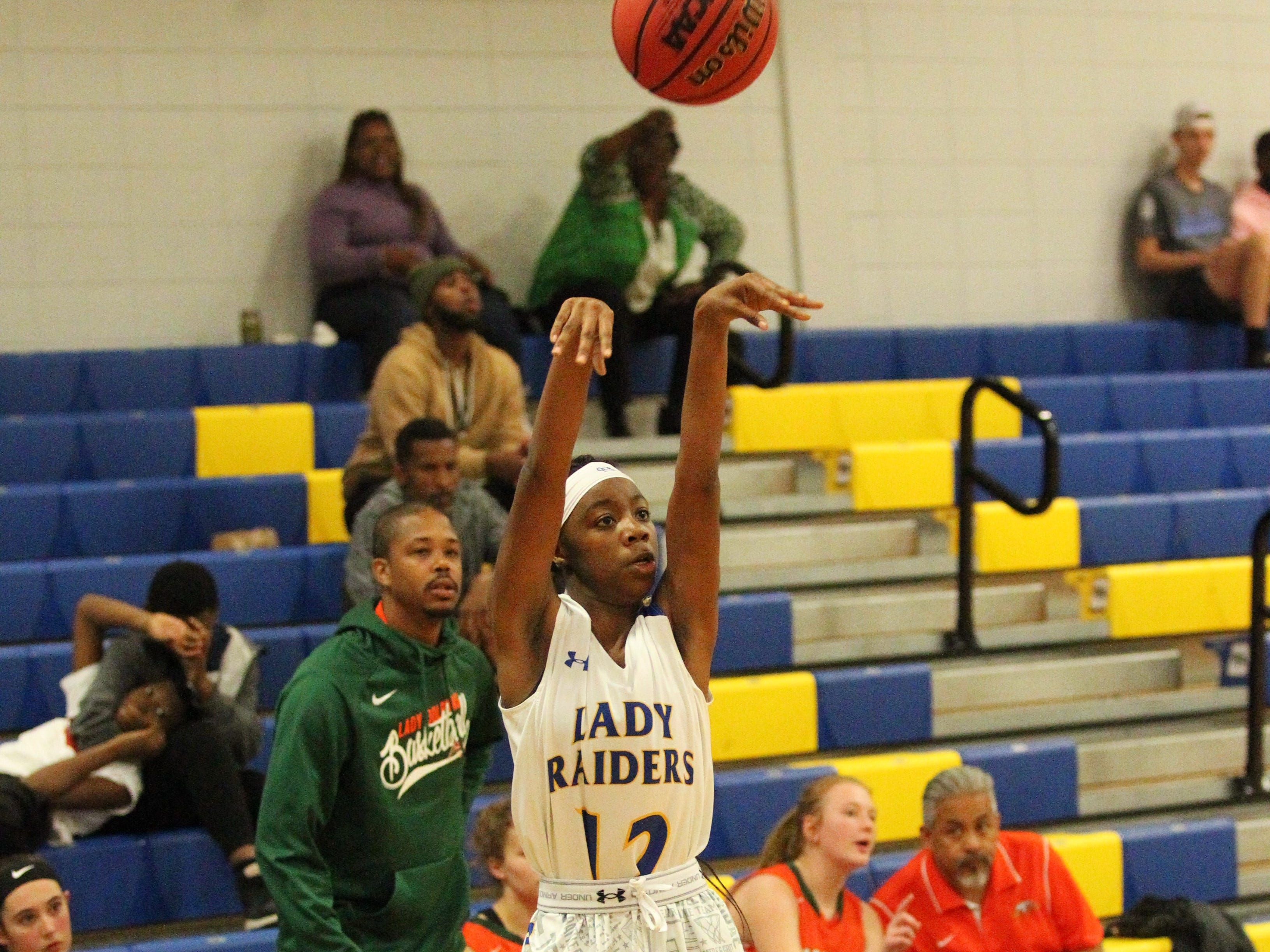 Rickards' Ja'Kiyah Robinson drills a 3-pointer as Rickards' girls basketball team beat Mosley 61-27 in a Region 1-6A quarterfinal on Feb. 14, 2019.