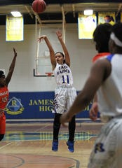 Rickards' La'Niyah Lee shoots a mid-range jumper as Rickards' girls basketball team beat Mosley 61-27 in a Region 1-6A quarterfinal on Feb. 14, 2019.