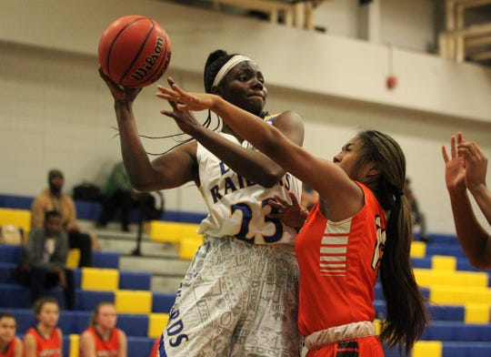 Rickards' Renia Hawkins throws a pass from the post as Rickards' girls basketball team beat Mosley 61-27 in a Region 1-6A quarterfinal on Feb. 14, 2019.