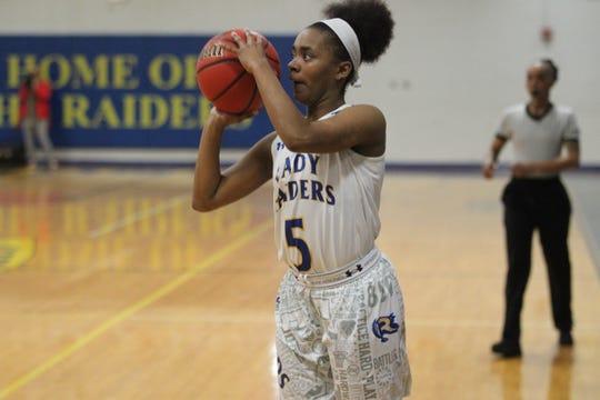 Rickards' Denia Love shoots a 3-pointer as Rickards' girls basketball team beat Mosley 61-27 in a Region 1-6A quarterfinal on Feb. 14, 2019.