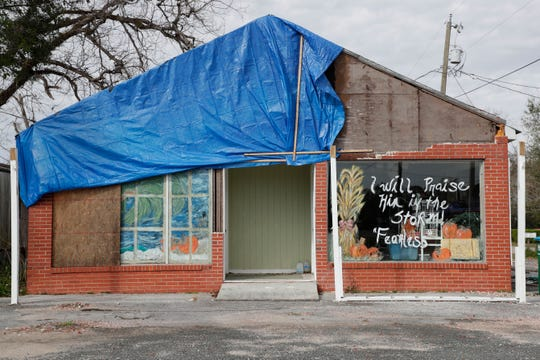 A business in Bristol, Fla. with half of the roof covered in a tarp, Friday Feb. 15, 2019. The roof was damaged by Hurricane Michael in Oct. 2018.