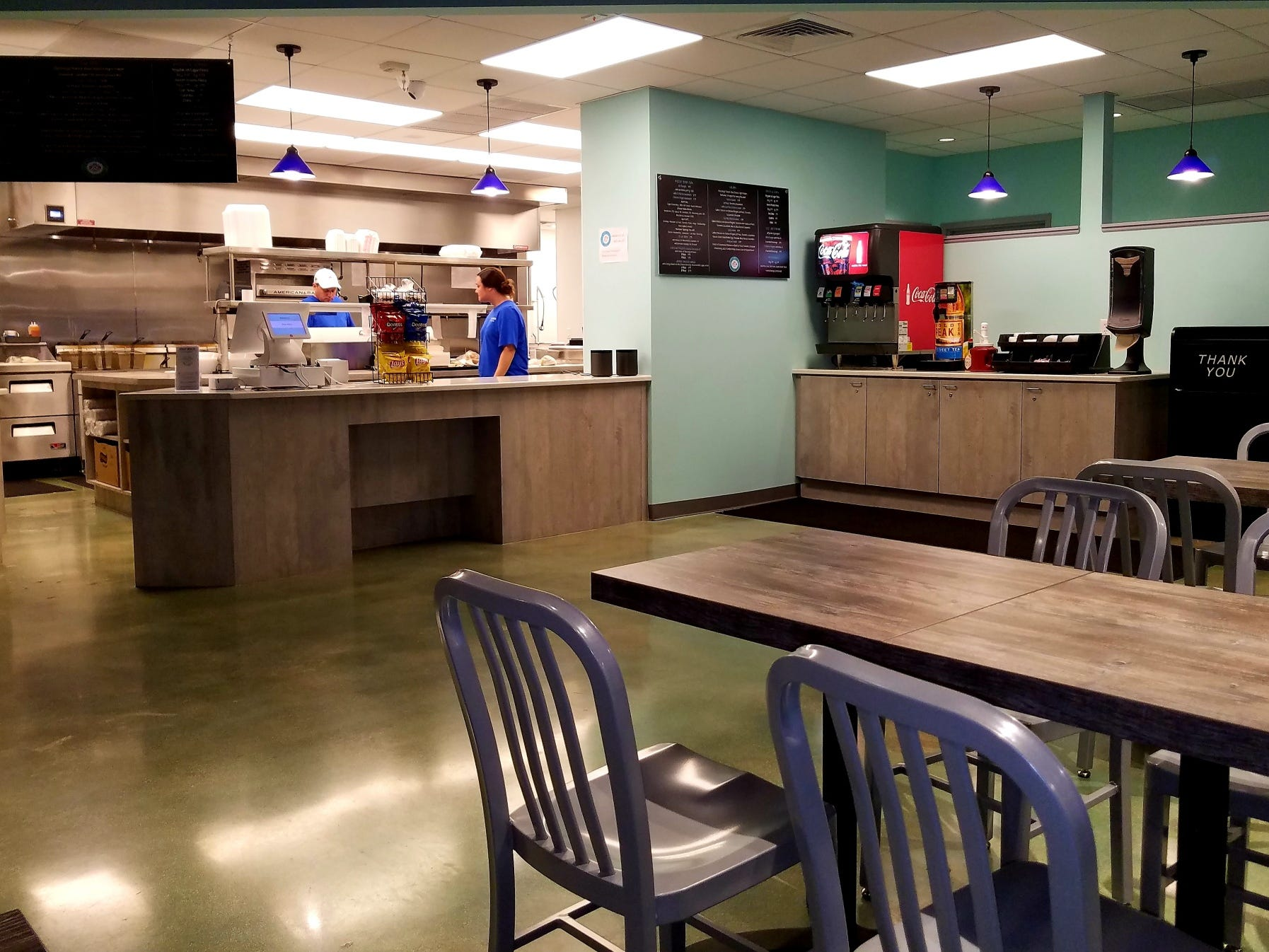 Inside Fast Joe's. Order at the counter, get your own drink, food is delivered to your table.