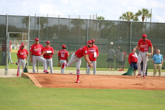 Cardinals pitcher Jack Flaherty stretches his arm after reporting Feb. 13 to Roger Dean Chevrolet Stadium in Jupiter for Spring Training.