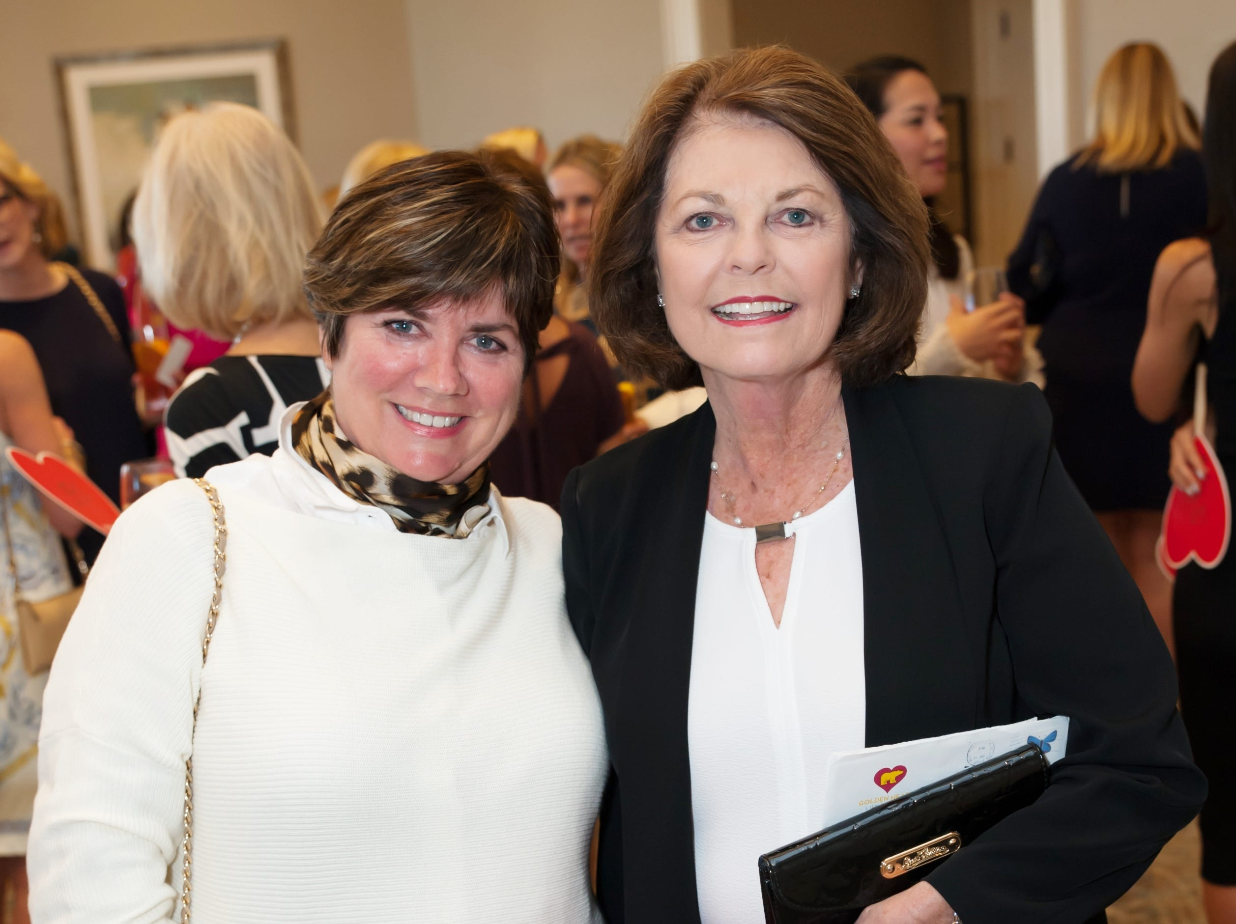Lorri Wesselman, left, and Gail Eissey at the Golden Heart Luncheon in Palm Beach Gardens.