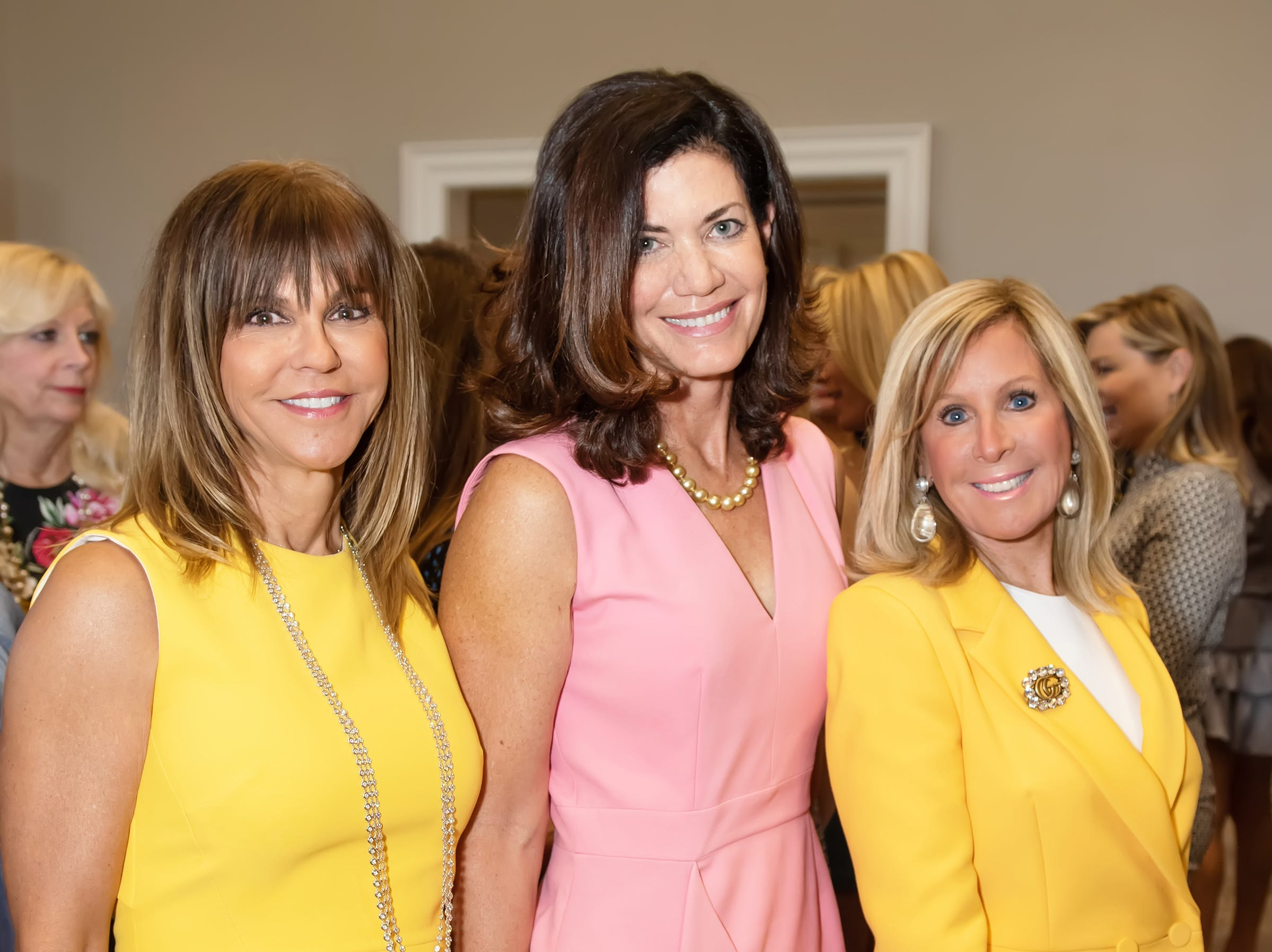 Soula Rifkin, left, Suzanne Carrol and Debbie Ernst at the Golden Heart Luncheon in Palm Beach Gardens.