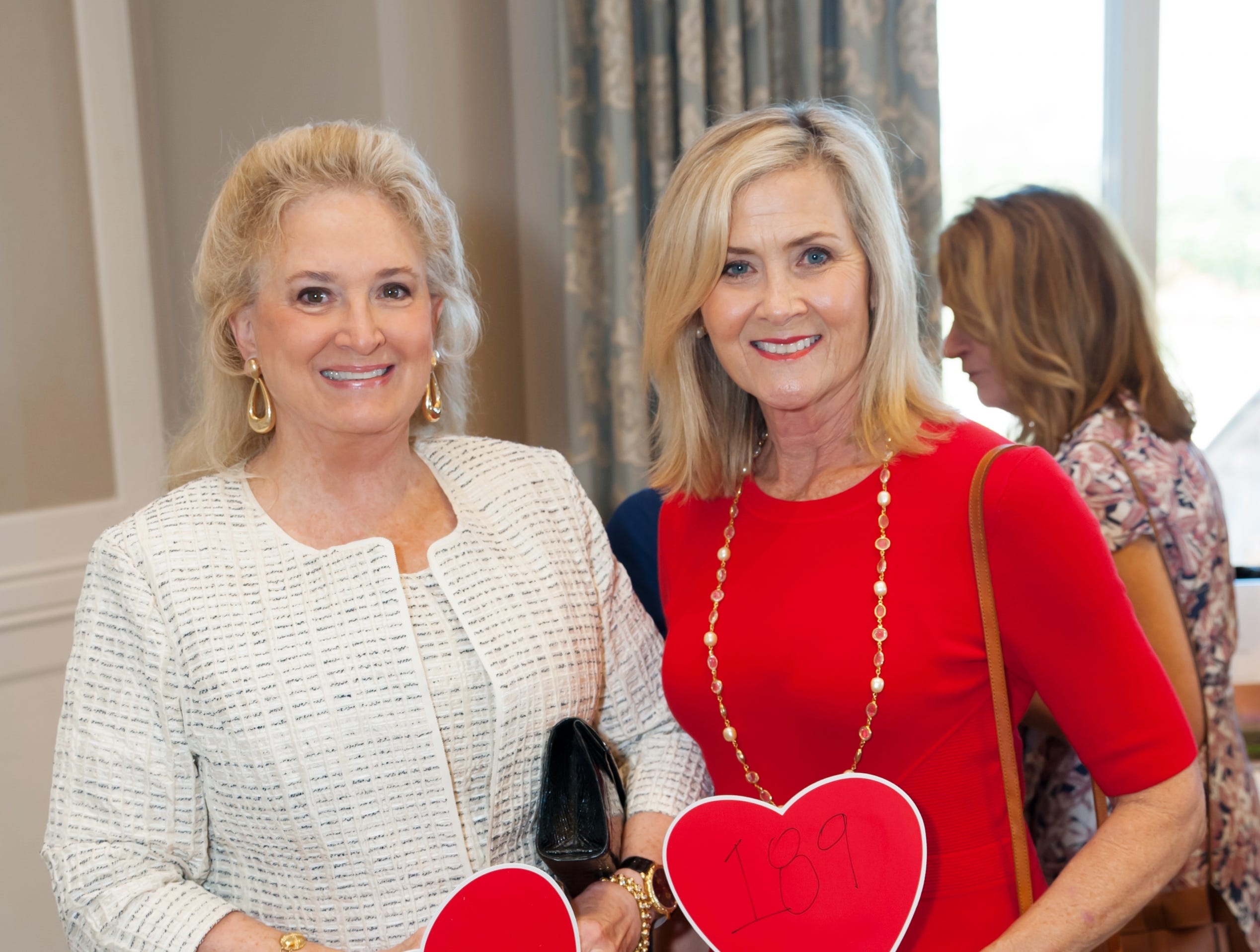 Kathryn Vecellio, left, and Wanda Doumar at the Golden Heart Luncheon in Palm Beach Gardens.
