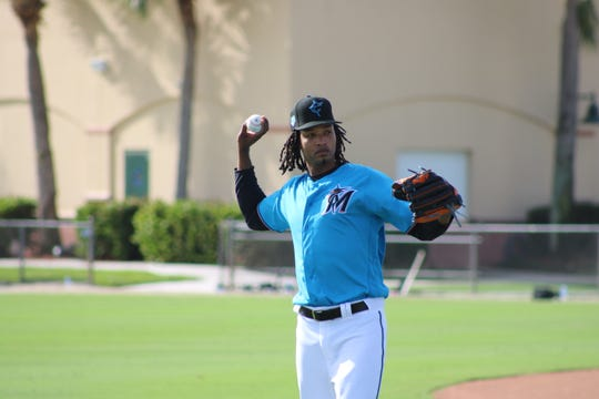Marlins pitcher Jose Urena warms up at Roger Dean Chevrolet Stadium in Jupiter after reporting for Spring Training on Feb. 13. Urena has already been named Miami's Opening Day starter for the 2019 season.