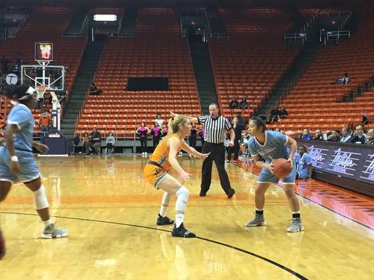 Louisiana Tech's Raizel Guinto looks for a passing lane againnst the defense of UTEP's Katarina Zec Thursday night at the Don Haskins Center