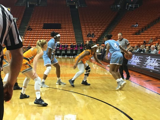 Louisiana Tech's Kierra Anthony looks over her options against the defense of UTEP's Neidy Ocuane Thursday night at the Don Haskins Center