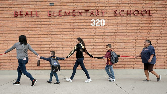 Parents, students and activists circled Beall Elementary School on Thursday, Feb. 14, 2019, as though to hug the school to show El Paso Independent School District officials that they do not want their school to close. The district voted to close the school and send its students to Douglass Elementary School. Parents at Beall say Douglass is too close to a recycling plant that fuels their contamination fears.