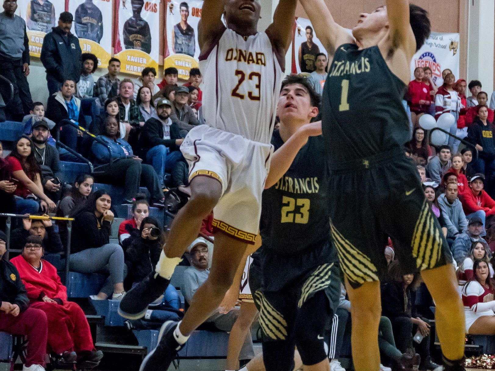 Oxnard's Stacy Johnson goes up for a shot during the Yellowjackets' 61-49 win in a Division 3AA quarterfinal Thursday night.