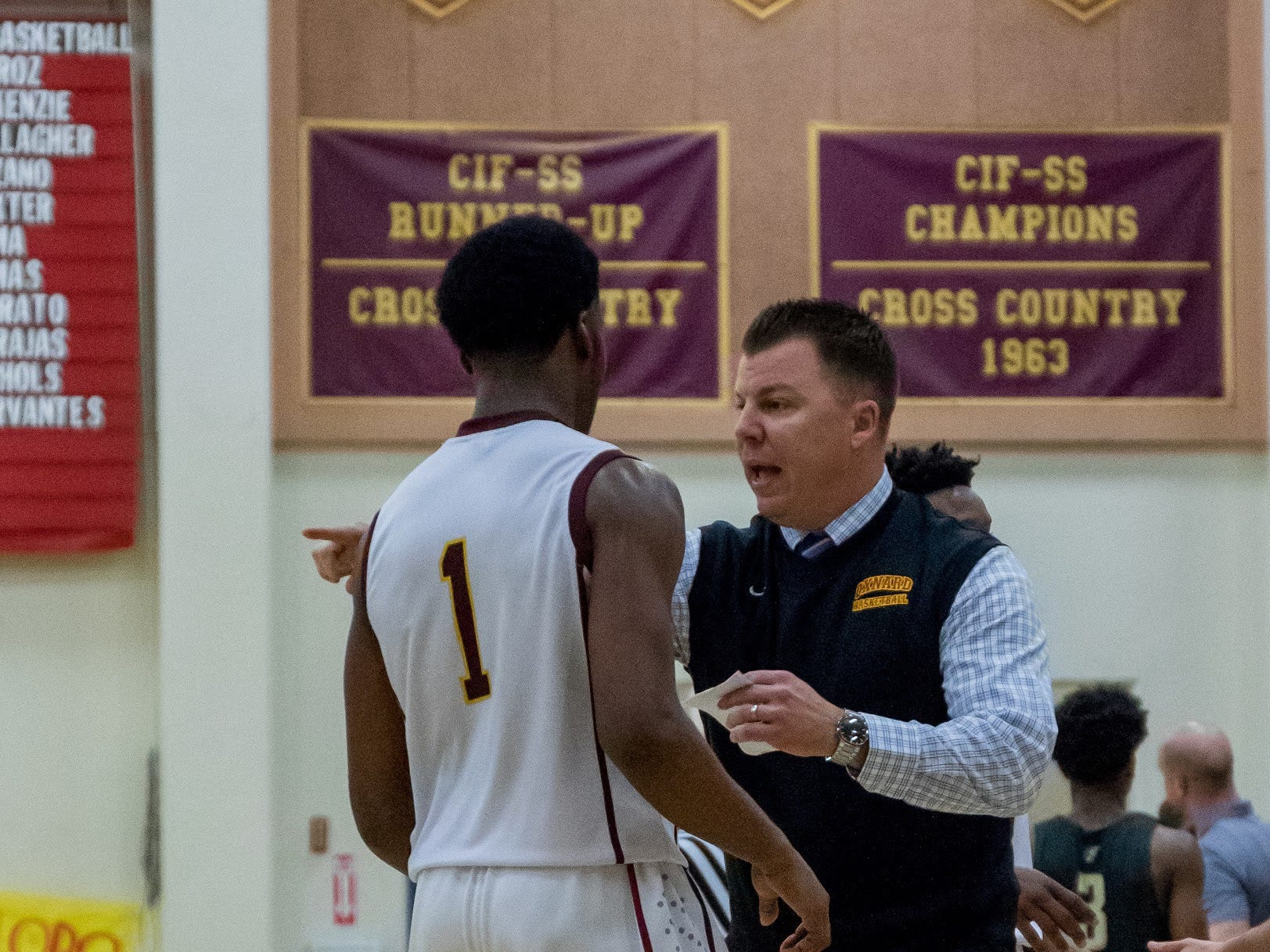 Oxnard head coach Jeff Staniland gives instructions to J.R Waters during the Yellowjackets' 61-49 win in a Division 3AA quarterfinal Thursday night.