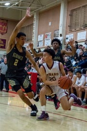 Oxnard's Christian Manabat looks for an open teammate during the Yellowjackets' 61-49 win in a Division 3AA quarterfinal Thursday night.
