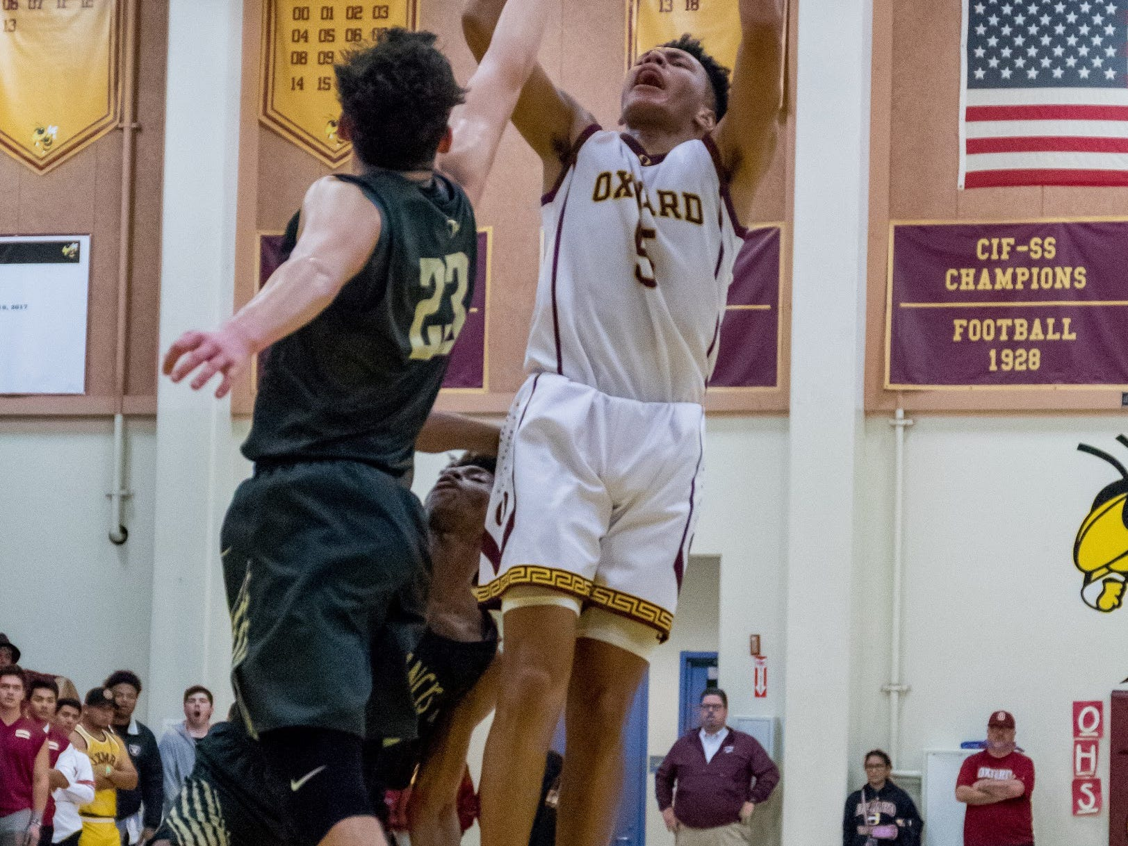 Oxnard's Dominic Brown shoots over a St. Francis defender during the Yellowjackets' 61-49 win in a Division 3AA quarterfinal Thursday night.