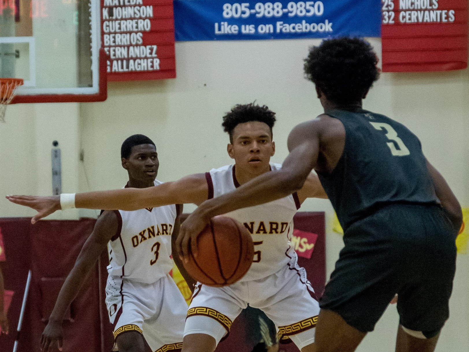 Oxnard's Dominic Brown gets in a defensive position during the Yellowjackets' 61-49 win in a Division 3AA quarterfinal Thursday night.
