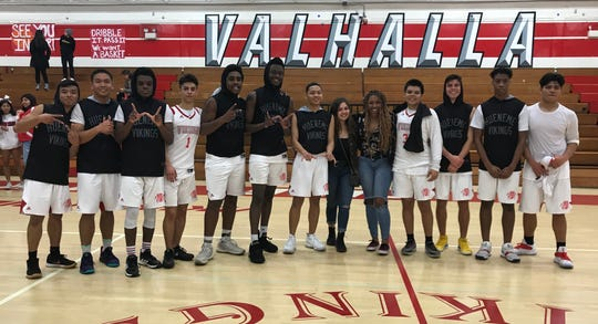 The Hueneme High boys basketball team poses with friends after defeating Moreno Valley-Riverside County Education Academy 59-53 in a CIF-Southern Section Division 5AA quarterfinal at home Thursday night.