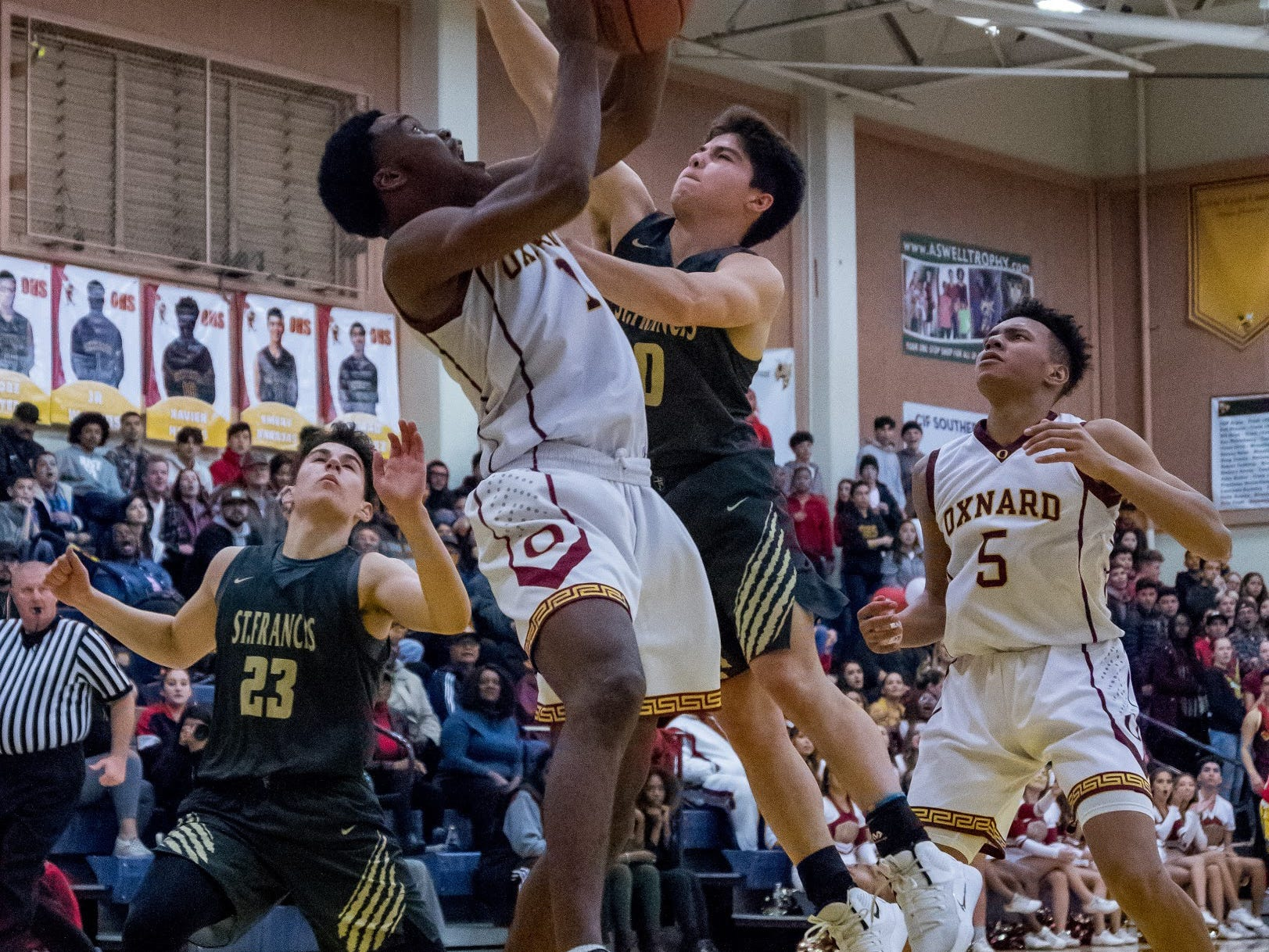Oxnard's J.R Waters goes strong to the basket during the Yellowjackets' 61-49 win in a Division 3AA quarterfinal Thursday night.